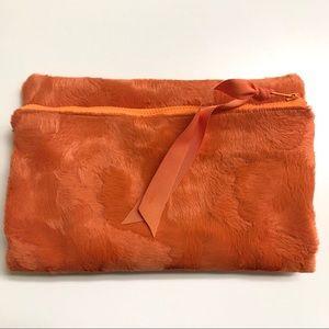 Faux fur fold over zip clutch